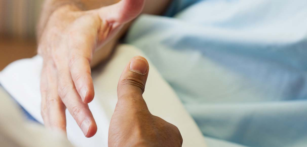 Hospital: Patient And Doctor Shake Hands